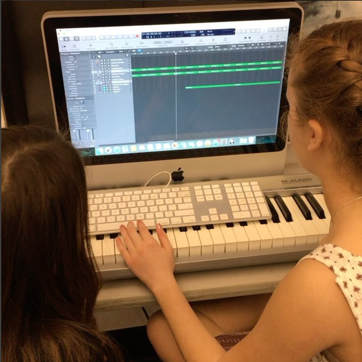 Student working on Vocal music project on an iMac