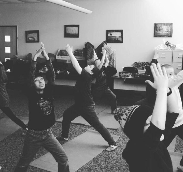 Black and White of Students doing yoga